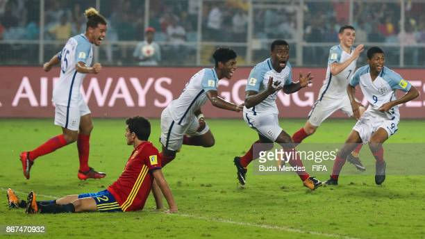 Marc Guehi of England celebrates with his teammates after scoring their fourth goal during the FIFA U17 World Cup India 2017 Final match between...