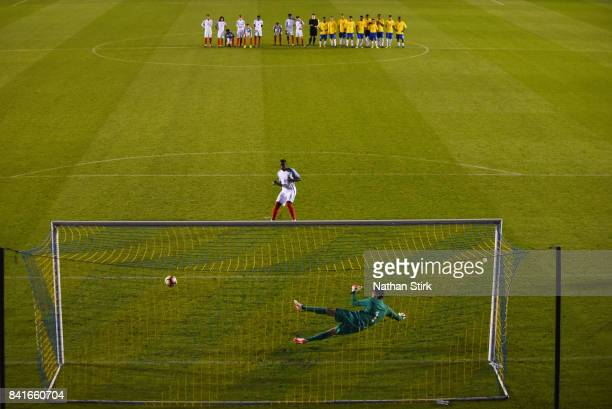 Marc Guehi of England scores the winning penalty during the international friendly match between England U18 and Brazil U18 on September 1 2017 in...