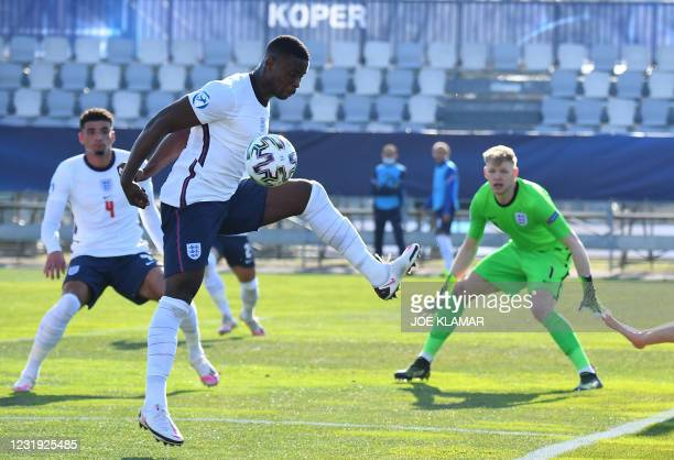 Marc Guehi of England stops the ball during the 2021 UEFA European Under-21 Championship Group D football match between England and Switzerland at...