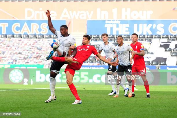 Marc Guehi of Swansea City battles with George Friend of Birmingham City during the Sky Bet Championship match between Swansea City and Birmingham...