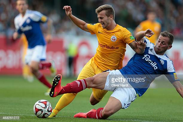 Marc Heider of Kiel and David Blacha of Rostock compete for the ball during the 3 Bundesliga match Holstein Kiel and Hansa Rostock at HolsteinStadion...