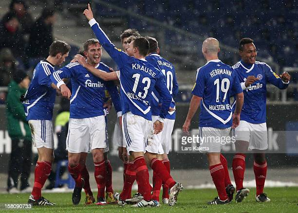 Marc Heider of Kiel celebrates his first team goal with his teammate during the Regionalliga Nord match between Hannover 96 II and Holstein Kiel at...