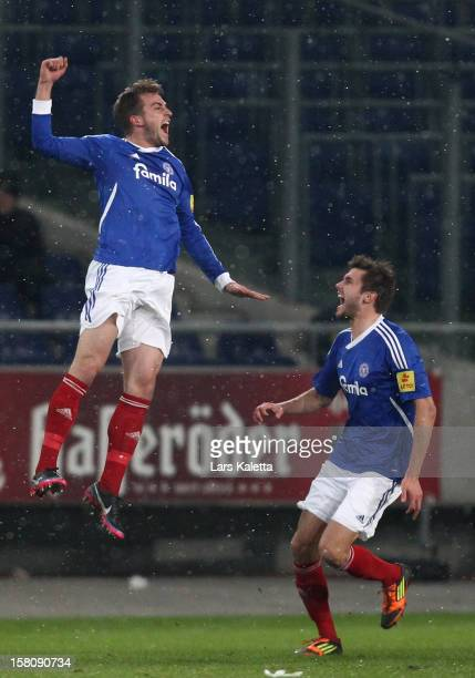Marc Heider of Kiel celebrates his team's first goal with Fabian Wetter during the Regionalliga Nord match between Hannover 96 II and Holstein Kiel...