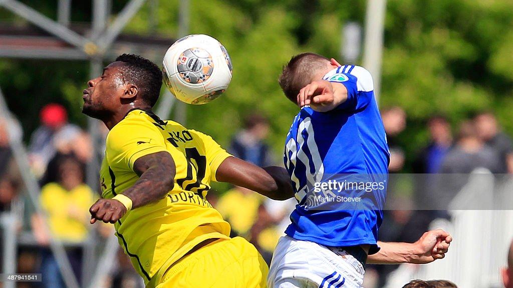 Marc Heider Of Kiel Challenges Evans Nyarko Of Dortmund Ii During The News Photo Getty Images