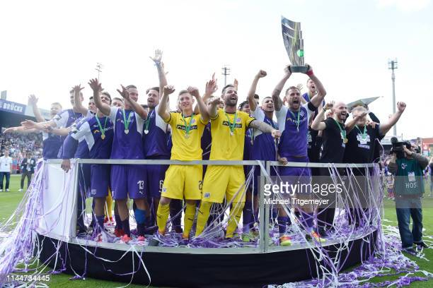 Marc Heider of Osnabrueck and team mates celebrate with the third League trophy after the 3 Liga match between between VfL Osnabrueck and SpVgg...