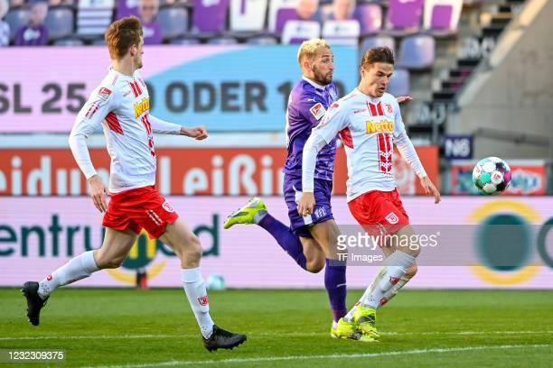 Marc Heider of VfL Osnabrueck and Jan Elvedi of SSV Jahn Regensburg battle for the ball during the Second Bundesliga match between VfL Osnabrück and...