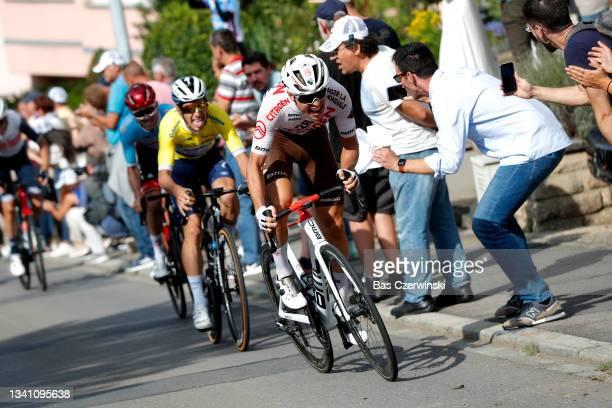 Marc Hirschi of Switzerland and UAE Team Emirates blue points jersey, João Almeida of Portugal and Team Deceuninck - Quick-Step yellow leader jersey...