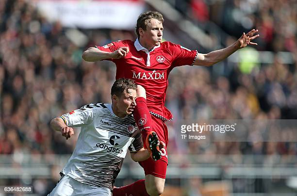 Marc Hornschuh of FC St Pauli and Jon Dadi Boedvarsson of Kaiserslautern battle for the ball during the Second Bundesliga match between FC St Pauli...