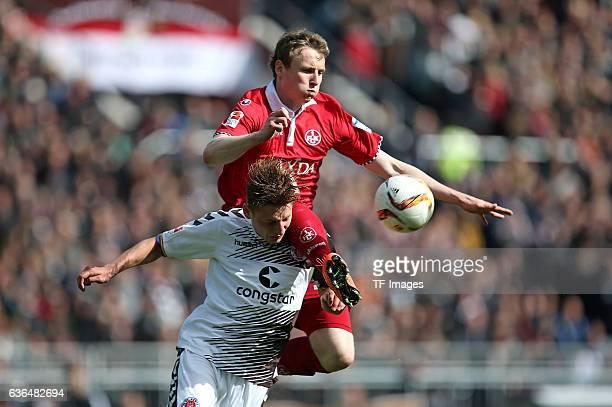Marc Hornschuh of FC St Pauli and Jon Dadi Boedvarsson of Kaiserslautern battle for the ball during the Second Bundesliga match between FC St Pauli...