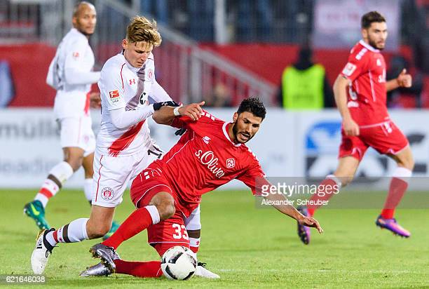 Marc Hornschuh of St Pauli challenges Elia Soriano of Wuerzburg during the Second Bundesliga match between FC Wuerzburger Kickers and FC St Pauli at...