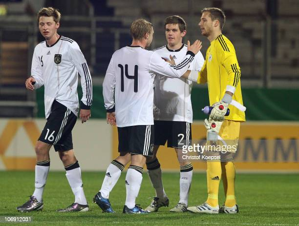 Marc Hornschuh Patrick Funk Sebastian Jung and Oliver Baumann of Germany celebrate the victory after the U21 international friendly match between...