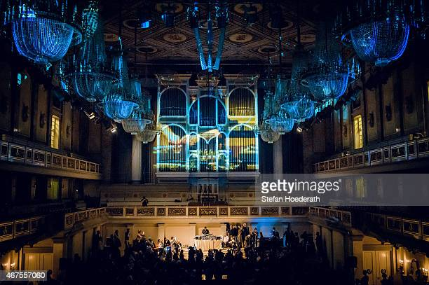 Marc Hype performs live on stage in front of a projection on the organ-pipes of the Konzerthaus during Yellow Lounge organized by recording label...