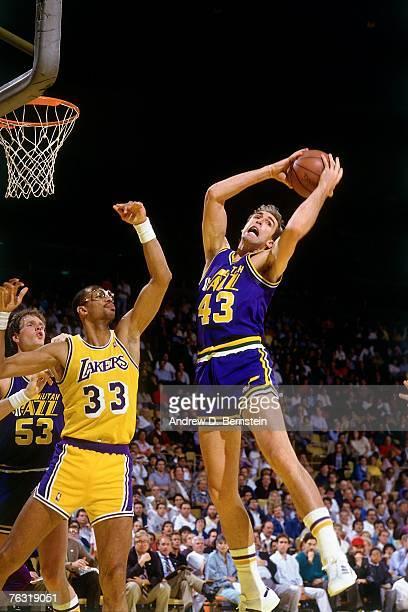 Marc Iavaroni of the Utah Jazz rebounds against Kareem AbdulJabbar of the Los Angeles Lakers in 1986 at the Great Western Forum in Inglewood...