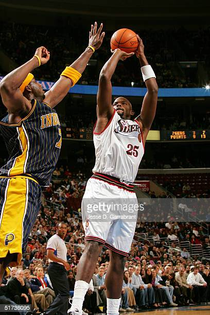 Marc Jackson of the Philadelphia 76ers shoots against Jermaine O'Neal of the Indiana Pacers on November 12 2004 at the Wachovia Center in...