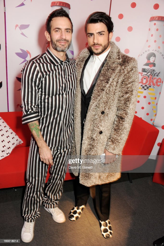 Marc Jacobs (L) and Harry Louis attend a party celebrating 30 years of Diet Coke and announcing designer Marc Jacobs as Creative Director for Diet Coke in 2013 at the German Gymnasium Kings Cross on March 11, 2013 in London, England.