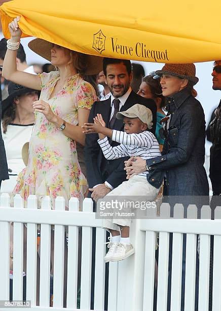 Marc Jacobs and Madonna with her son David watch the 2009 Veuve Clicquot Manhattan Polo Classic on Governor's Island on May 30 2009 in New York City