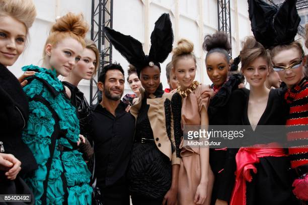 Marc Jacobs and Models attend Backstage at the Louis Vuitton Ready-to-Wear A/W 2009 fashion show during Paris Fashion Week on March 12, 2009 in...