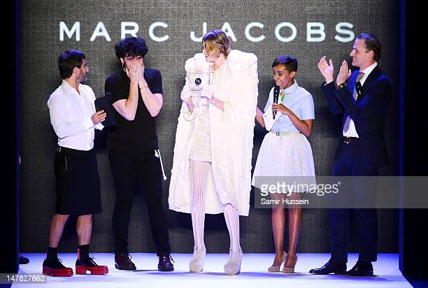 Marc Jacobs hands over the Designer For Tomorrow award to Designer Leandro Cano during the Designer For Tomorrow Show at the MercedesBenz Fashion...
