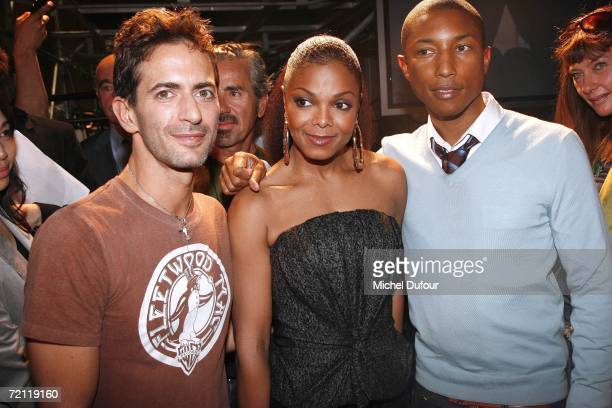 Marc Jacobs Janet Jackson and Pharrell Williams pose for a photograph backstage at the Louis Vuitton Fashion Show as part of Paris Fashion Week...
