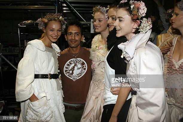 Marc Jacobs poses for a photograph with models backstage at the Louis Vuitton Fashion Show as part of Paris Fashion Week Spring/Summer 2007 on...