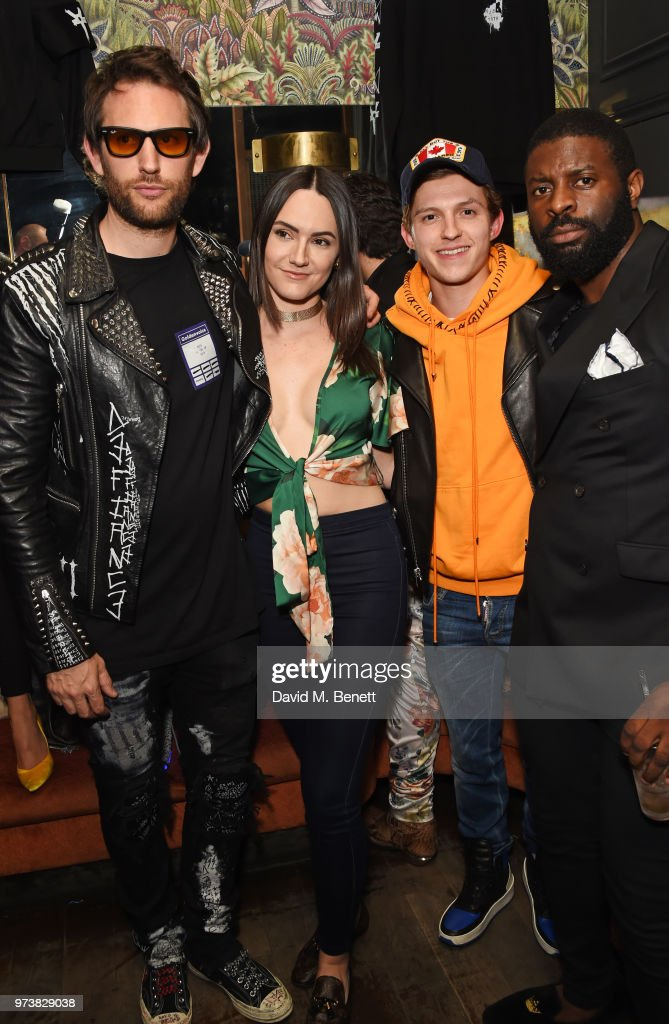 Marc Jacques Burton, guest, Tom Holland and Jay Udo-Udoma attend the MJB x YOTA fashion capsule party supported by Ciroc who have designed MJB x YOTA Limited Edition Bottles at The Scotch of St James on June 13, 2018 in London, England.