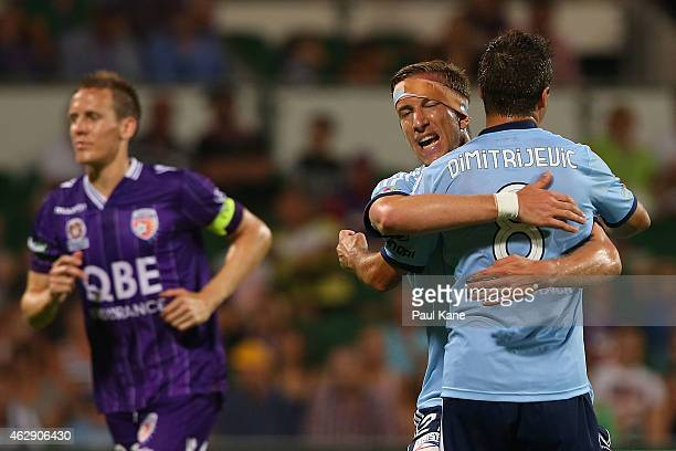 Marc Janko and Milos Dimitrijevic of Sydney celebrate a goal during the round 16 A-League match between the Perth Glory and Sydney FC at nib Stadium...