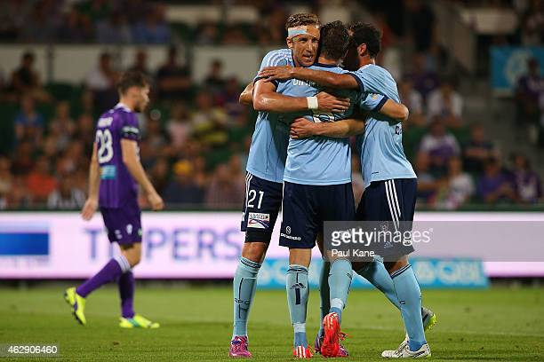 Marc Janko, Milos Dimitrijevic and Alex Brosque of Sydney celebrate a goal during the round 16 A-League match between the Perth Glory and Sydney FC...