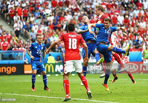 Marc Janko of Austria gets up above Kari Arnason of Iceland to meet a cross during the UEFA EURO 2016 Group F match between Iceland and Austria at...
