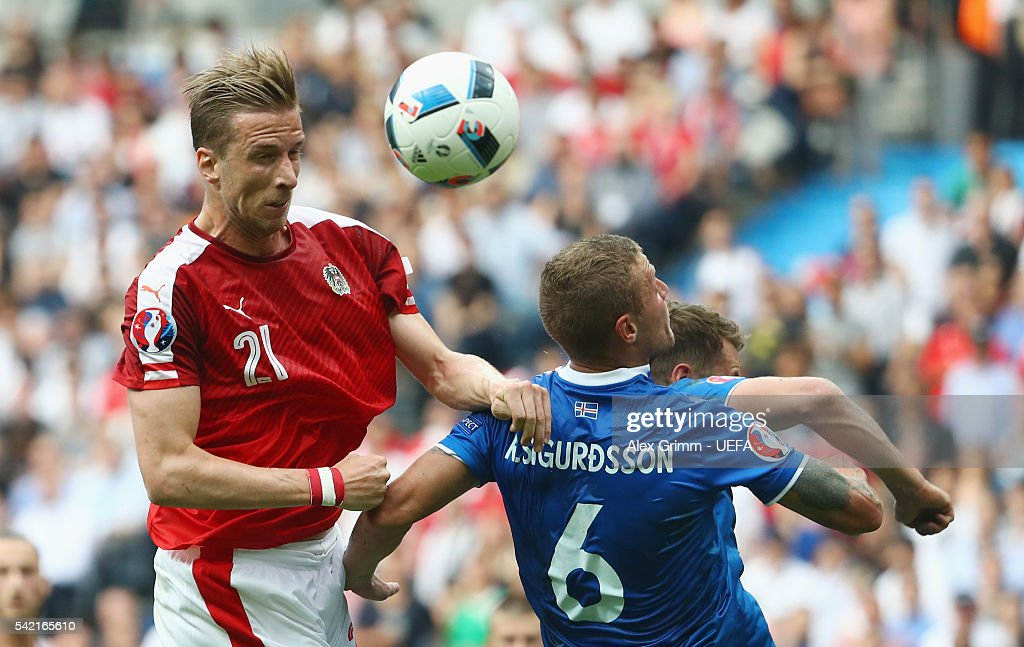 Marc Janko (L) of Austria jumps for a header with Ragnar Sigurdsson of Iceland during the UEFA EURO 2016 Group F match between Iceland and Austria at Stade de France on June 22, 2016 in Paris, France.