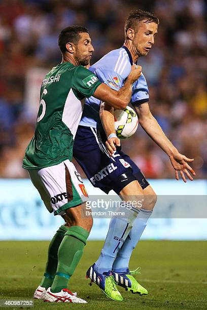 Marc Janko of Sydney competes with Adrian Madaschi of the Jets during the round 15 ALeague match between Sydney FC and Newcastle Jets at WIN Stadium...