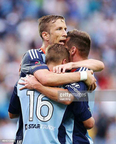 Marc Janko of Sydney FC celebrates with Alex Gersbach and Shane Smeltz after scoring a goal during the round 18 ALeague match between Sydney FC and...