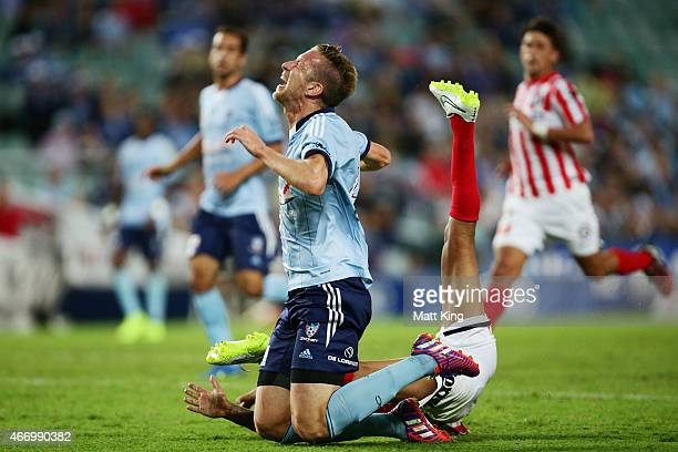 Marc Janko of Sydney FC is brought down by Patrick Kisnorbo of Melbourne City during the round 22 ALeague match between Sydney FC and Melbourne City...
