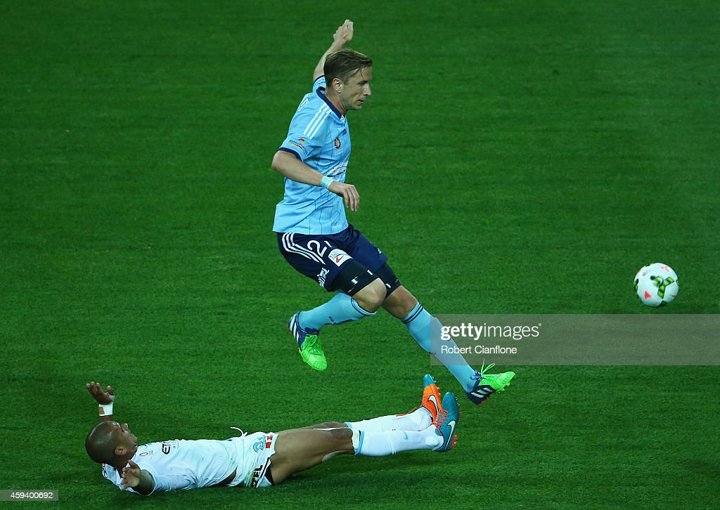 Marc Janko of Sydney FC is challenged by Patrick Kisnorbo of Melbourne City during the round seven A-League match between Melbourne City and Sydney FC at AAMI Park on November 22, 2014 in Melbourne, Australia.