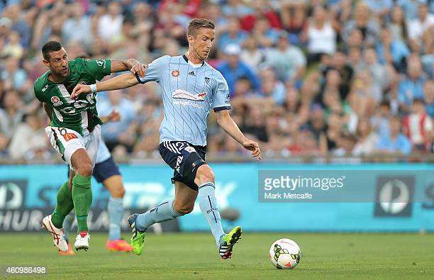 Marc Janko of Sydney shrugs off Angela Salem of the Jets to get a shot at goal during the round 15 ALeague match between Sydney FC and Newcastle Jets...