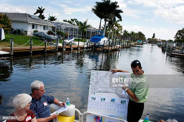 Marc Joseph the owner of Foreclosures 'R Us realty company displays a map showing foreclosed properties to prospective buyers as they motor down a...