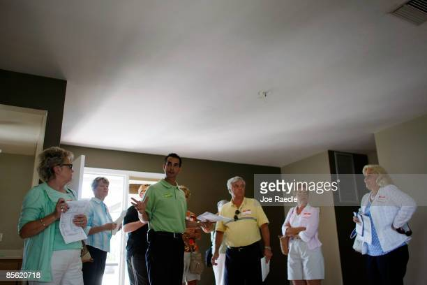 Marc Joseph the owner of Foreclosures 'R Us realty company shows a home to prospective buyers during a foreclosure boat tour on March 26 2009 in Cape...