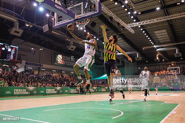 Marc Judith of JSF Nanterre is at the basket against Linas Kleiza of Fenerbahce Ulker Istanbul during the game between JSF Nanterre and Fenerbahce...