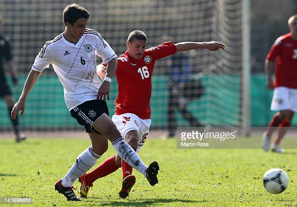 Marc Kempf of Germany and Kiril Despodov of Bulgaria battle for the ball during the U17 Men's Elite Round match between Germany and Bulgaria on March...