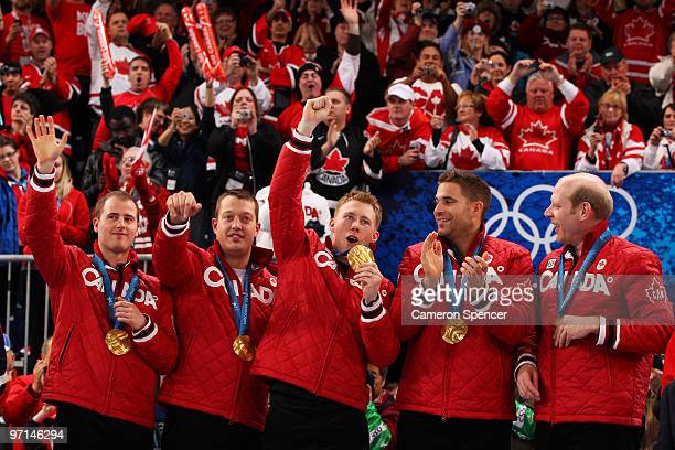 Marc Kennedy John Morris Kevin Martin Ben Hebert and Adam Enright of Canada celebrate with their gold medals after the Curling Men's Gold medal game...