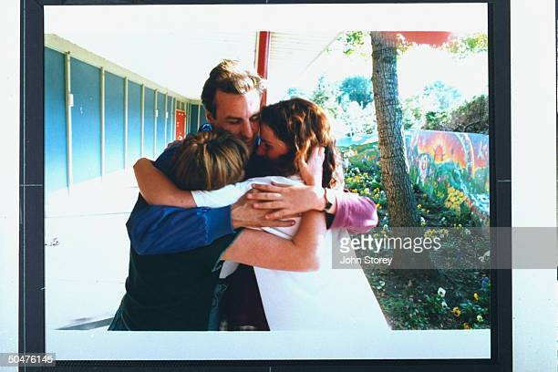 Marc Klaas father of kidnapmurder victim Polly Klaas embracing Polly's friends Annette Schott Kate McLean Gillian Pelham nr mural they painted in...