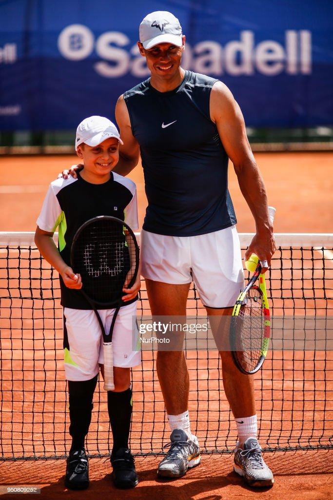 Marc Krajekian, a 10-year-old cancer survivor playing with Rafa Nadal