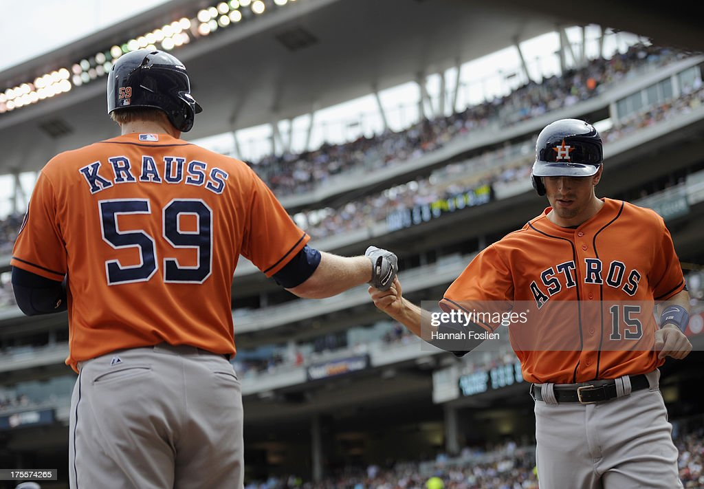 Marc Krauss #59 of the Houston Astros congratulates teammate Jason Castro #15 on scoring a run against the Minnesota Twins during the fifth inning of the game on August 4, 2013 at Target Field in Minneapolis, Minnesota.