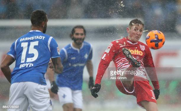Marc Lais of Regensburg is challenged by Terrence Boyd of Darmstadt during the Second Bundesliga match between SV Darmstadt 98 and SSV Jahn...