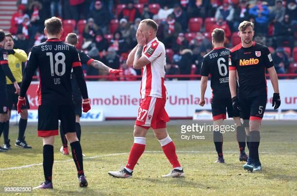 Marc Lais of SSV Jahn Regensburg Toni Leistner of 1 FC Union Berlin and Benedikt Gimber of SSV Jahn Regensburg during the Bundesliga game between...