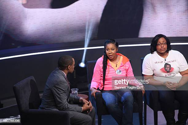 Marc Lamont Hill and Esaw Garner and Emerald Garner attend Justice For UsBET Town Hall Live at BET studio on December 10 2014 in New York City