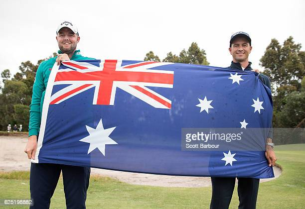 Marc Leishman and Adam Scott of Australia pose with the Australian flag ahead of the World Cup of Golf at Kingston Heath Golf Club on November 23...