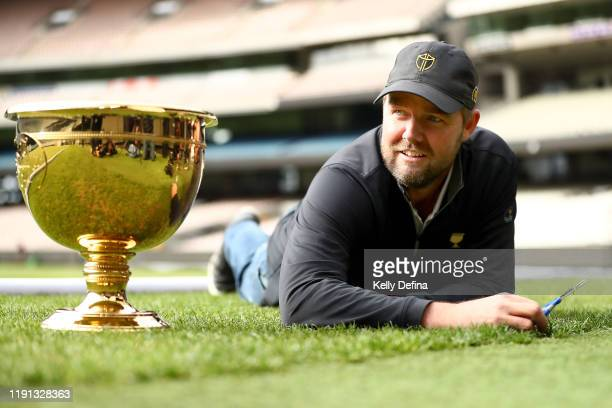 Marc Leishman cuts the grass on the MCG ahead of the 2019 Presidents Cup, at Melbourne Cricket Ground on December 02, 2019 in Melbourne, Australia.