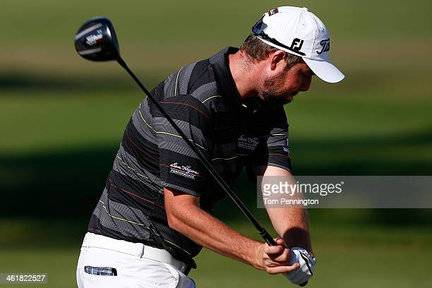 Marc Leishman hits a shot on the first tee during the third round of the Sony Open in Hawaii at Waialae Country Club on January 11 2014 in Honolulu...