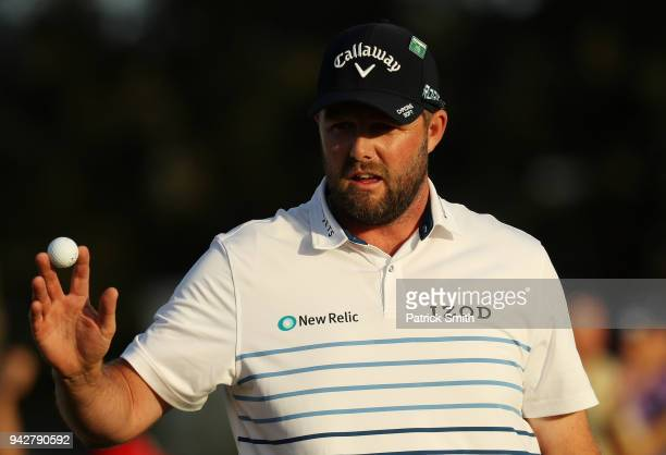 Marc Leishman of Australia acknowledges the crowd on the 18th green during the second round of the 2018 Masters Tournament at Augusta National Golf...