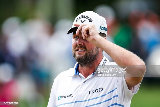 Marc Leishman of Australia acknowledges the crowd on the 18th hole during the final round of the CIMB Classic at TPC Kuala Lumpur on October 14 2018...